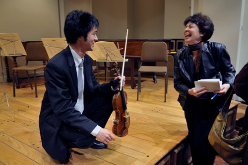 Post-concert, graduate student Francis Liu shares his experience playing the Greffuhle Strad with an audience member